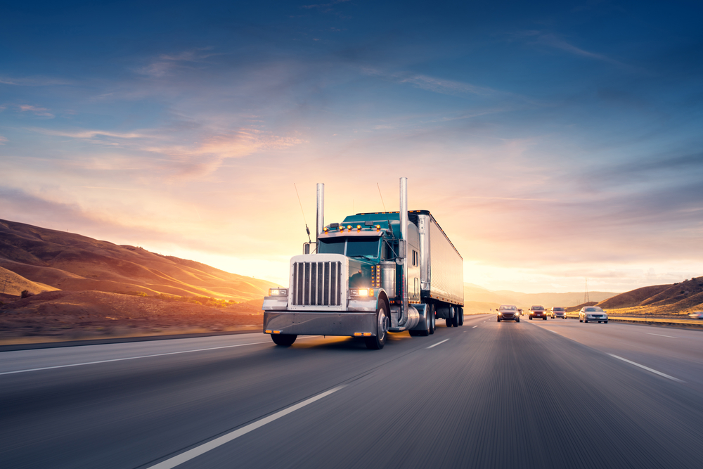 big-rig-truck-driving-sunset